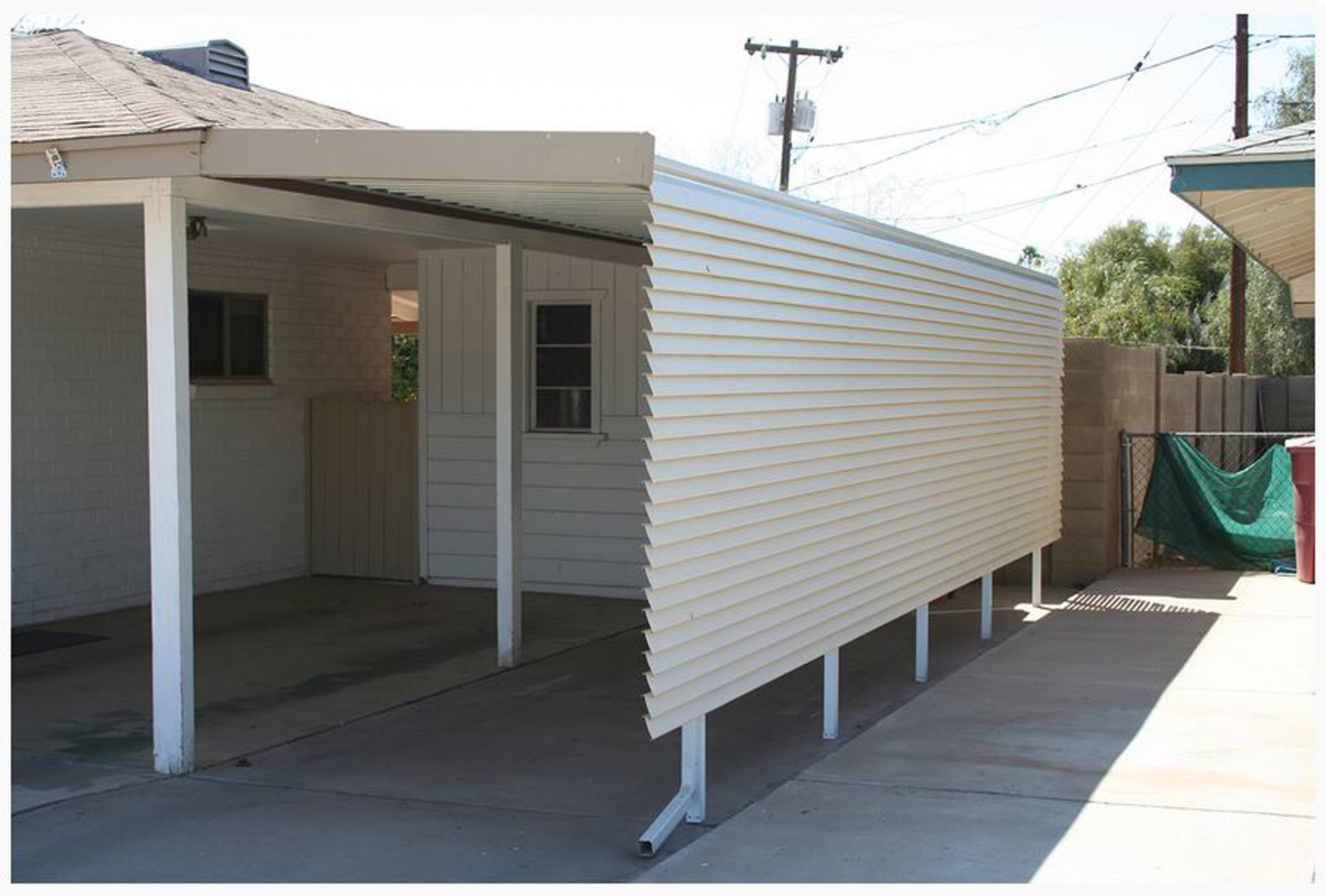 Carport-with-privacy-panel